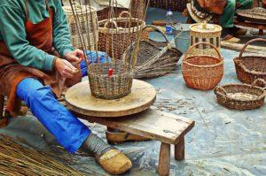 A man weaving a basket