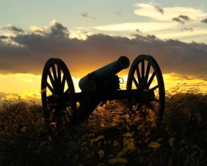 A Civil War cannon at sunset.