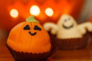 A Halloween pumpkin cupcake.